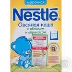 Каша детская Нестле овсяная молочная с яблоком и абрикосом 250г Россия