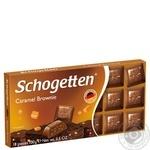 Шоколад молочний Schogetten з начинкою брауні з шматочками печива з какао та з шматочками карамелі 100г