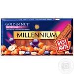 Millennium Golden Nut Chocolate milk with whole hazelnuts and raisins 100g