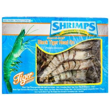 Креветки Tiger гигантские тигровые сыромороженные с головой 16/20 1кг - купить, цены на Метро - фото 1