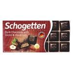 Шоколад Schogetten чорний з какао-вершковою начинкою та шматочками фундука 100г