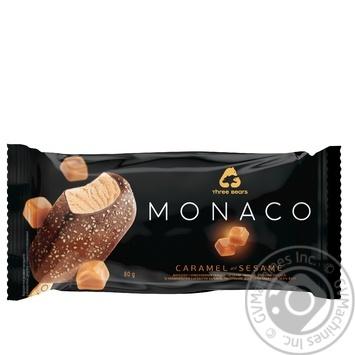 Мороженое Три Медведя Monaco Карамель-кунжут в глазури на палочке 80г - купить, цены на Novus - фото 1