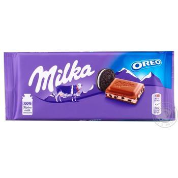 Шоколад молочный Milka с кремовой начинкой и кусочками печенья Орео 100г - купить, цены на МегаМаркет - фото 1