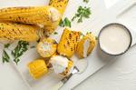 Corn under cheese sauce