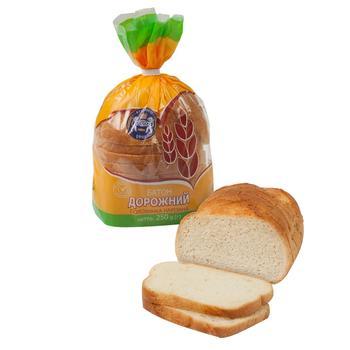 Батон Кулиничі Дорожній пшеничний половинка нарізаний 250г - купить, цены на Ашан - фото 1