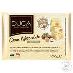 Шоколад білий Gran Nocciolato Bianco з цілими лісовими  горіхами та пластівцями 100г - купити, ціни на МегаМаркет - фото 1