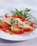 Рыбное филе, тушенное с помидорами, зеленью и чесноком